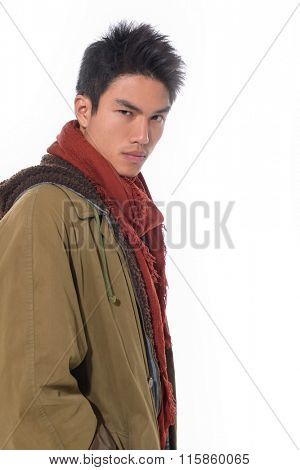 Fashion Shot of a young man in coat-white background