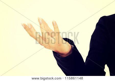 Businesswoman holding something in her slender hand