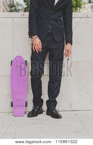 Detail Of A Model Posing With His Skateboard
