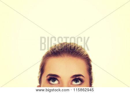 Beautiful female eyes looking up