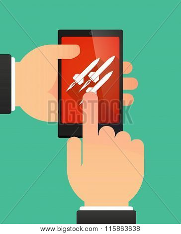 Man Using A Phone Showing Missiles