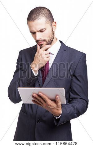 Businessman looking worried to his digital tablet, isolated on white background