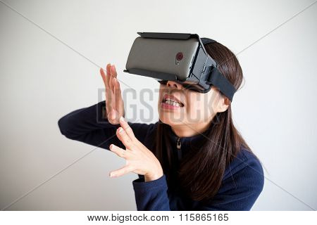 Asian Woman wear with vr device and feeling afraid