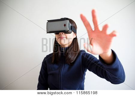 Young Woman wear with reality device and hand want to touch something