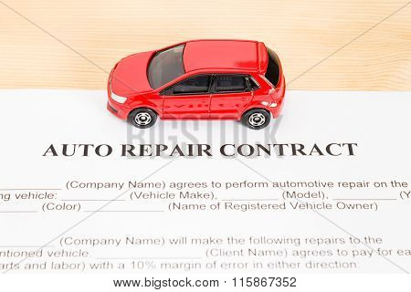 Auto Repair Contract With Red Car On Center