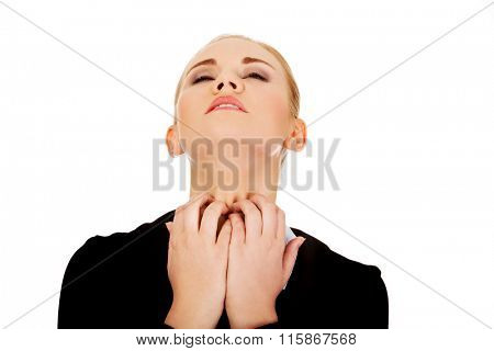 Young elegant woman scratching her neck