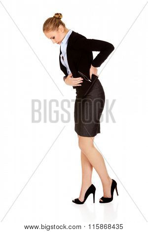 Business woman with back problems and stomach ache