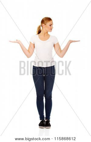 Young woman presenting something on open palms