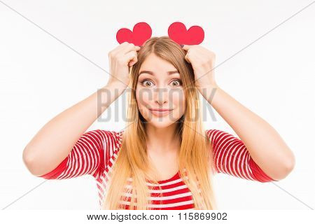 Pretty Girl Holding Two Paper Hearts Like Ears