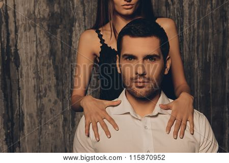 Close Up Photo Of Girl's Hands Lying On Shoulders Of Her Boyfriend