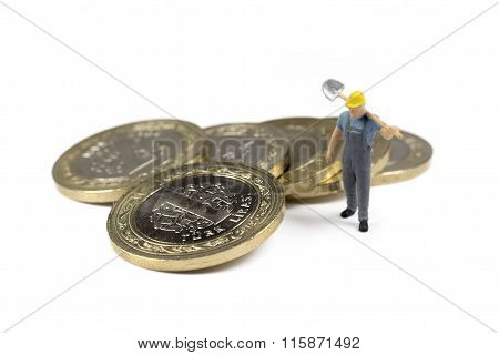Single Worker Standing Next To Turkish Coins