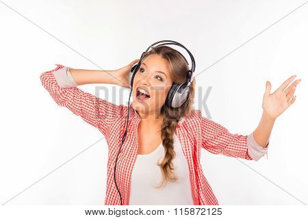 Happy Young Girl Listening To Music And Singing