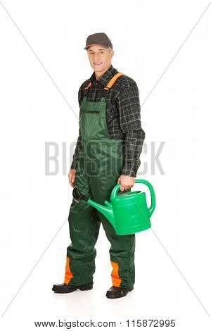 Workman holding green watering can