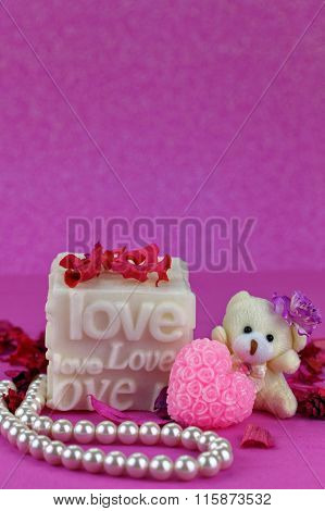 Small teddy bear with Love box.  Pink Background