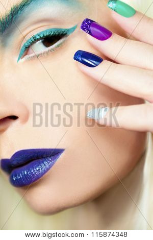 Blue turquoise makeup and manicure.