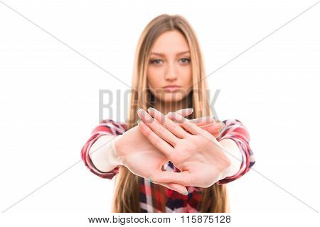 A Portrait Of Strict Girl With Prohibited Gesture