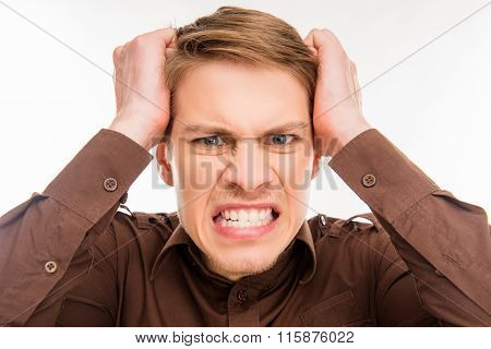 Young Angry Furios Man Toucing His Head, Close Up Photo
