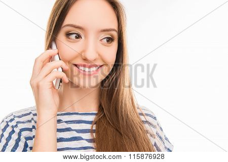 Happy Pretty Girl Talking On The Phone And Smiling