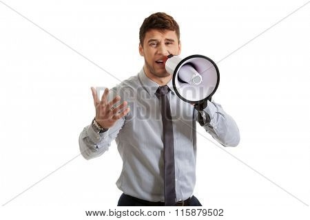 Businessman shouting through megaphone.