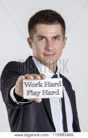 Work Hard Play Hard - Young Businessman Holding A White Card With Text
