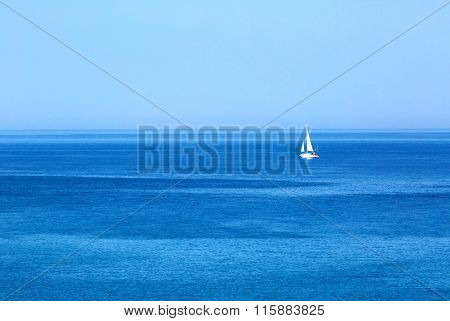 Sailing. Ship yacht with white sails in the open Sea. Luxury boats