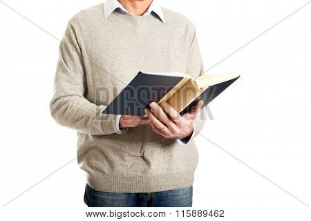 Male hands holding a book