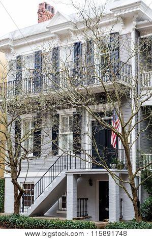 American Flag On Grey Siding Traditional Home