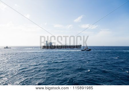 Tanker And Tugs On Horizon