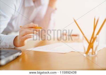 Closeup Of A Woman Freelancer Works In The Office At The Table.