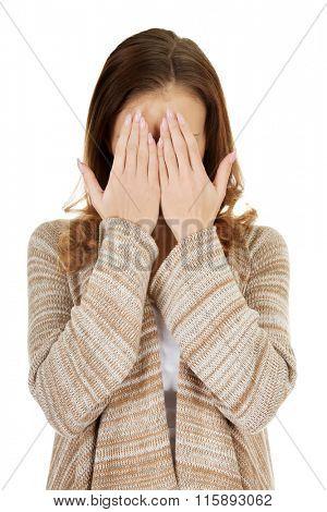 Beautiful woman covering face.
