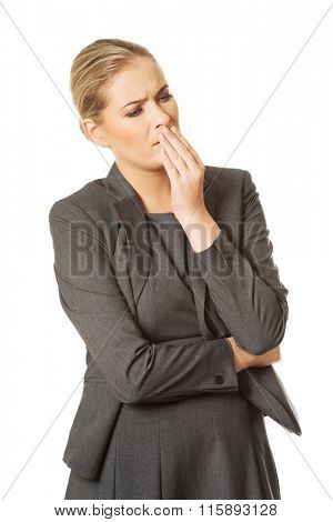 Sick woman about to vomit