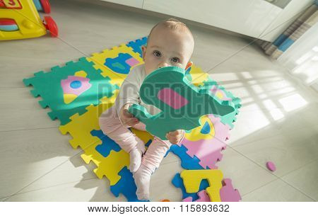 Baby Playing With Foam Puzzle