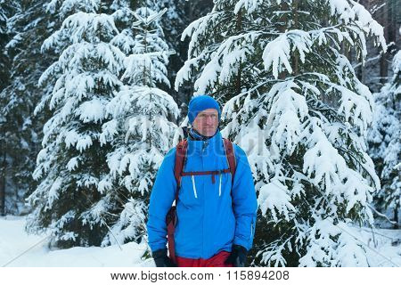 Happy Hiker Man Standing In Winter Forest