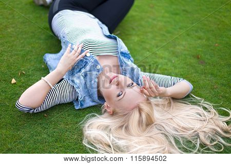 Beautiful Lying On The Green Grass With Untressed Hair