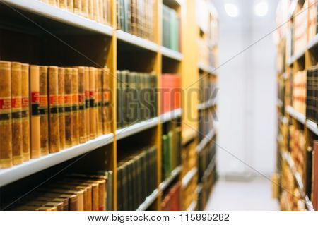 Blurred Background of Old Books On Shelfs