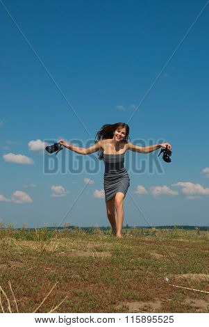 Barefooted Girl Running With Her Shoes