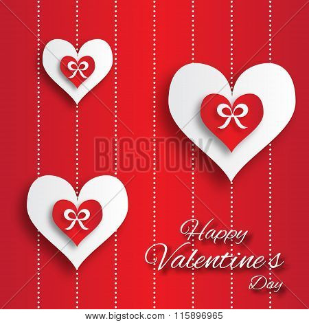 Valentine's day abstract applique background with cut paper hearts with bow ribbon .