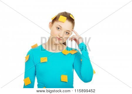 Young woman covered with post it notes.