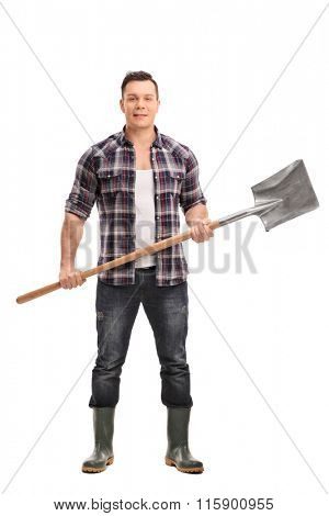Full length portrait of a young agricultural worker holding a shovel and looking at the camera isolated on white background