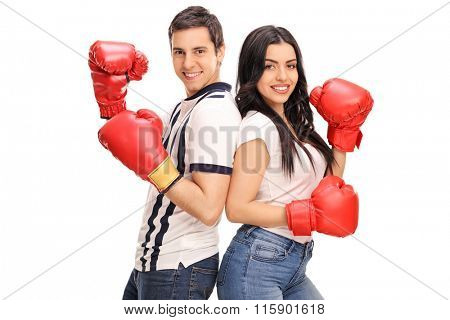 Young man and woman with boxing gloves posing together isolated on white background