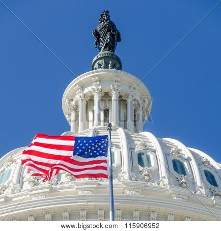 US Capitol Dome detail with waving National flag