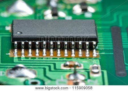 Black Chip On Green Circuit Board