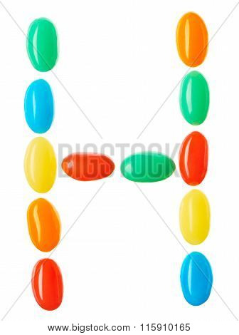 H Letter Made Of Multicolored Candies Isolated On White