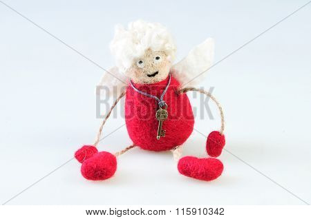 Woolen Handmade Toy Angel On A White Background . Felted Wool Toy.