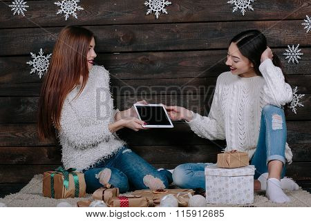 Sister gives her sister a tablet