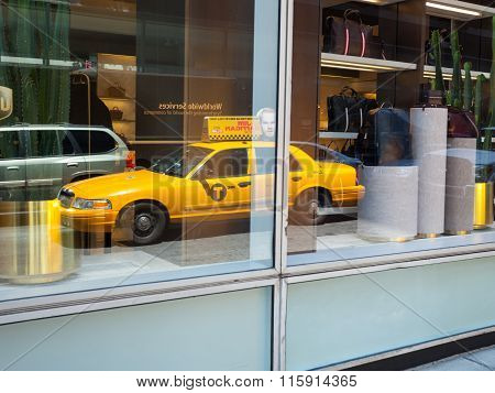 Reflection On The Window Of A Yellow Cab In Manhattan