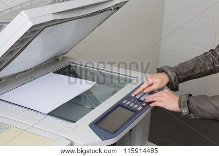 Business Woman Working With Printer In The Office