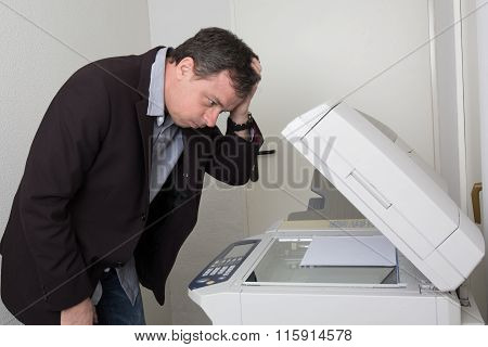 Stressed Man In Front Of A Copy Machine Isolated