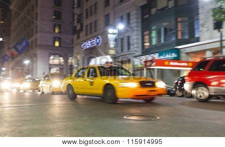 Yellow Cab At Night In New York City In Motion Blu.