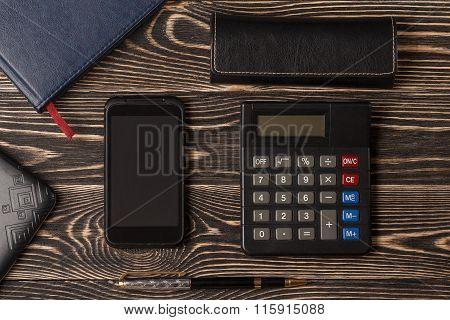 Pen, smartphone and calculator
